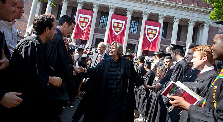 Harvard University President Drew Faust makes her way through the Yard as Harvard University celebrates Commencement 2011.  Justin Ide/Harvard Staff Photographer